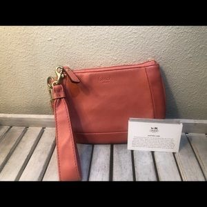 Coach, pink leather wristlet